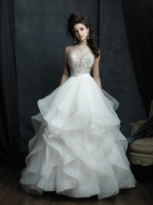 Пышное свадебное платье американского бренда Allure Bridals. Эффектное свадебное платье с летящей многослойной юбкой с волнами. Лиф украшен бисером, кристаллами и серебряным плетением.